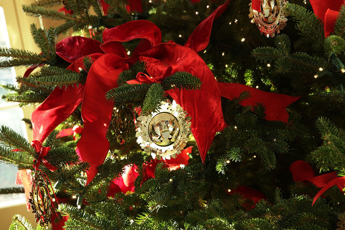 """WASHINGTON, DC - NOVEMBER 27:  Ornaments on a Christmas tree at the White House during a press preview of the 2017 holiday decorations November 27, 2017 in Washington, DC. The theme of the White House holiday decorations this year is """"Time-Honored Traditions.""""  (Photo by Alex Wong/Getty Images)"""