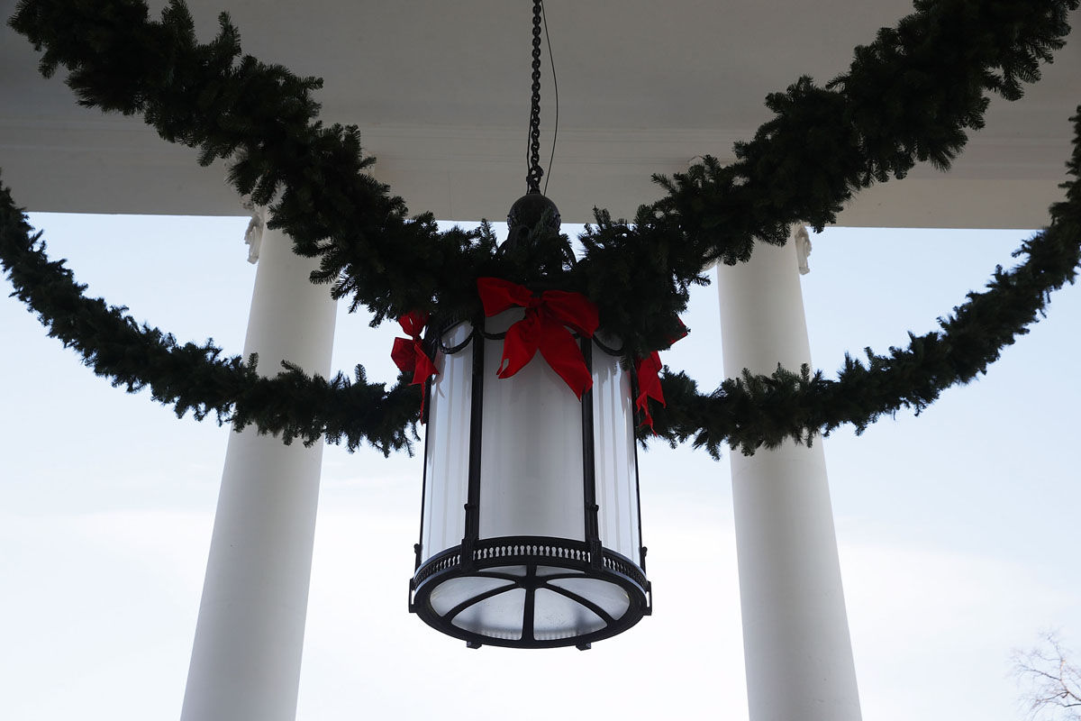 """WASHINGTON, DC - NOVEMBER 27:  Christmas decorations are seen at the North Portico of the White House during a press preview of the 2017 holiday decorations November 27, 2017 in Washington, DC. The theme of the White House holiday decorations this year is """"Time-Honored Traditions.""""  (Photo by Alex Wong/Getty Images)"""