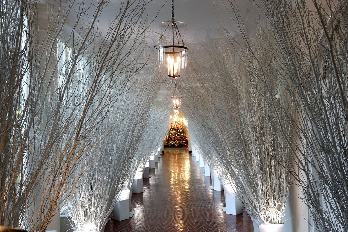 """WASHINGTON, DC - NOVEMBER 27:  Christmas decorations in a hallway of the East Wing of the White House during a press preview of the 2017 holiday decorations November 27, 2017 in Washington, DC. The theme of the White House holiday decorations this year is """"Time-Honored Traditions.""""  (Photo by Alex Wong/Getty Images)"""
