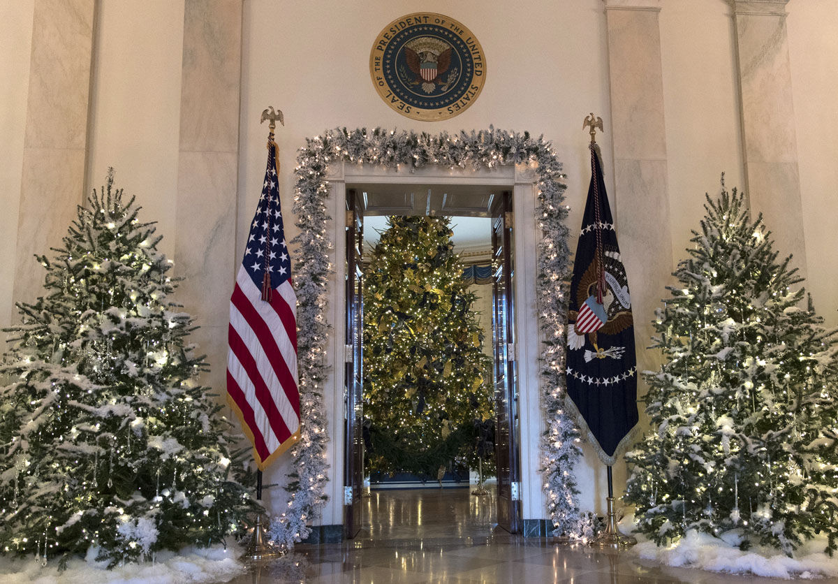 The official White House Christmas tree, center, is seen in the Blue Room during a media preview of the 2017 holiday decorations at the White House in Washington, Monday, Nov. 27, 2017. (AP Photo/Carolyn Kaster)
