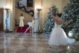 First lady Melania Trump watches a ballerinas perform a piece from The Nutcracker among the 2017 holiday decorations in the Grand Foyer of the White House in Washington, Monday, Nov. 27, 2017. The First Lady honored 200 years of holiday traditions at the White House. (AP Photo/Carolyn Kaster)