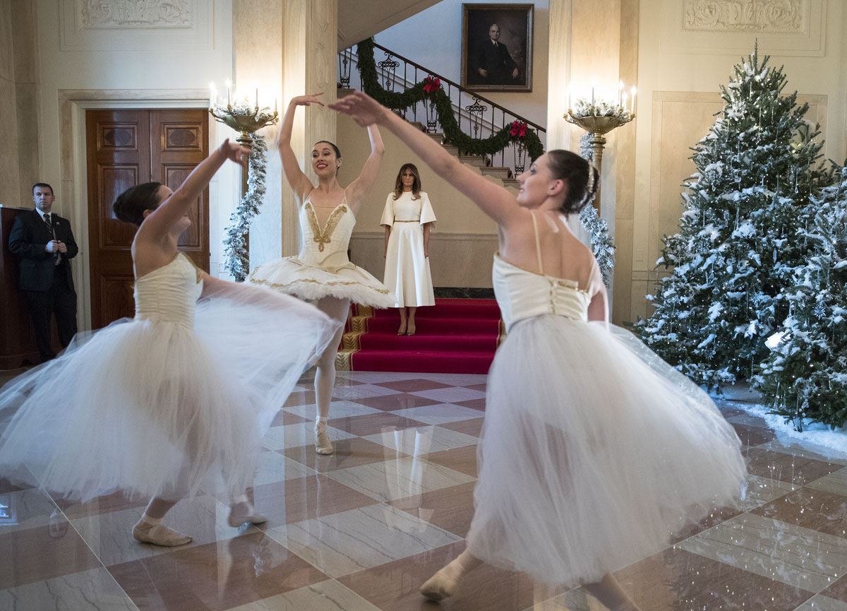 First lady Melania Trump watches as ballerinas perform a piece from The Nutcracker among the 2017 holiday decorations in the Grand Foyer of the White House in Washington, Monday, Nov. 27, 2017. The First Lady honored 200 years of holiday traditions at the White House. (AP Photo/Carolyn Kaster)