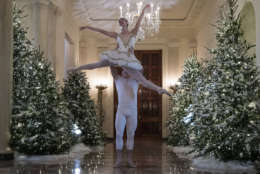A ballerina is lifted during a performance of a piece from The Nutcracker among the 2017 holiday decorations in the Cross Hall of the White House in Washington, Monday, Nov. 27, 2017. (AP Photo/Carolyn Kaster)