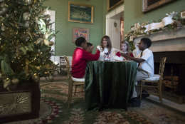 """First lady Melania Trump visits with children in the Green Room among the 2017 holiday decorations with the theme """"Time-Honored Traditions at the White House in Washington, Monday, Nov. 27, 2017. The First Lady honored 200 years of holiday traditions at the White House. (AP Photo/Carolyn Kaster)"""