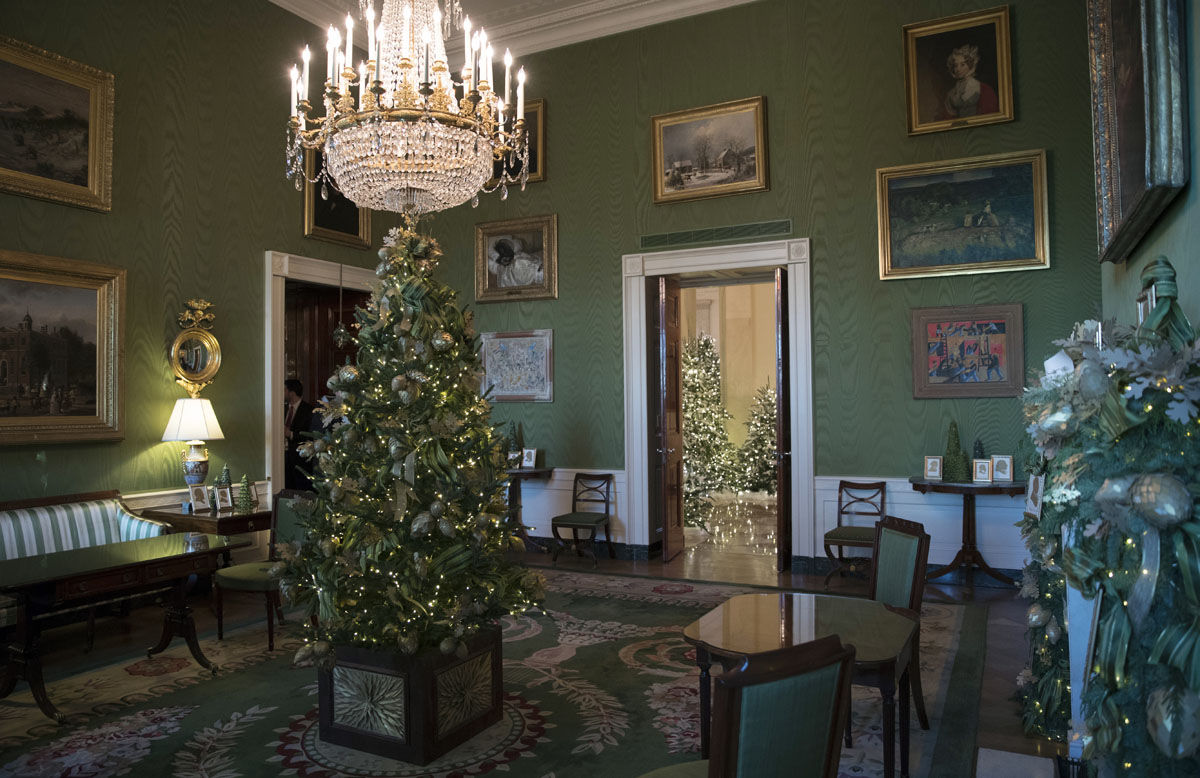 The Green Room with the 2017 holiday decorations is seen during a media preview tour of the White House in Washington, Monday, Nov. 27, 2017. (AP Photo/Carolyn Kaster)