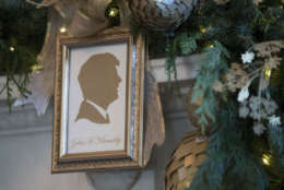 A silhouette of President John F. Kennedy is seen in the Green Room among the 2017 holiday decorations in the White House in Washington, Monday, Nov. 27, 2017. (AP Photo/Carolyn Kaster)