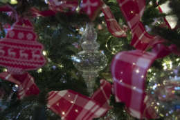 Christmas tree ornaments are seen in the Red Room during a media preview of the 2017 holiday decorations at the White House in Washington, Monday, Nov. 27, 2017. (AP Photo/Carolyn Kaster)