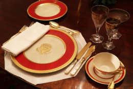 """WASHINGTON, DC - NOVEMBER 27:  Place setting is seen on a dining table in the China Room at the White House during a press preview of the 2017 holiday decorations November 27, 2017 in Washington, DC. The theme of the White House holiday decorations this year is """"Time-Honored Traditions.""""  (Photo by Alex Wong/Getty Images)"""