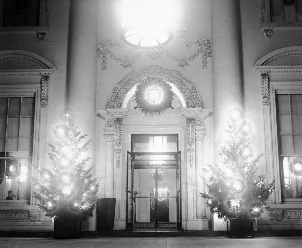 what with the lighted christmas trees in front of its portals in washington on dec 25 1931 the white house presented a beautiful softly illuminated