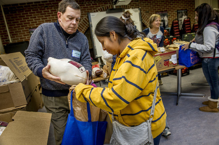Arlington Food and Assistance Center, AFAC, distributes food at the Technical center in Arlington of Walter Reed Drive. On the 19th, they also gave away turkeys in honor of Thanksgiving