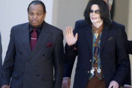 FILE - In this March 15, 2005 file photo, Pop star Michael Jackson leaves the Santa Barbara County Courthouse with his father, Joe, left, in Santa Maria, Calif., following a day of testimony in Jackson's trial on charges of child molestation. Jackson, 50, died in Los Angeles on Thursday, June 25, 2009. (AP Photo/Michael A. Mariant, file)