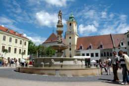 The Roland fountain and the Old Town Hall at Hlavni (main) Square in Bratislava, Slovakia, are seen on May 20, 2006. The Old Town district is the city's jewel, with cobblestone squares, narrow, labyrinthine streets and a castle offering sweeping views of the city and the Danube River. (AP Photo/Jan Koller, CTK)