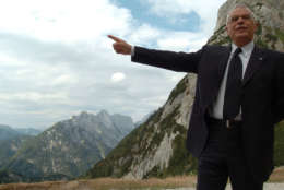 President of the European Parliament Josep Borrell points the highest mountain of Slovenia, Triglav, 2864 meters (9,396 feet) high, before attending the 90th anniversary of the Russian chapel built by the Russian prisoners in 1916 on the mountain road over the Vrsic pass, Slovenia, around 55 miles (88 km) north-west of Ljubljana, Sunday, July 30, 2006. (AP Photo/Denis Sarkic)