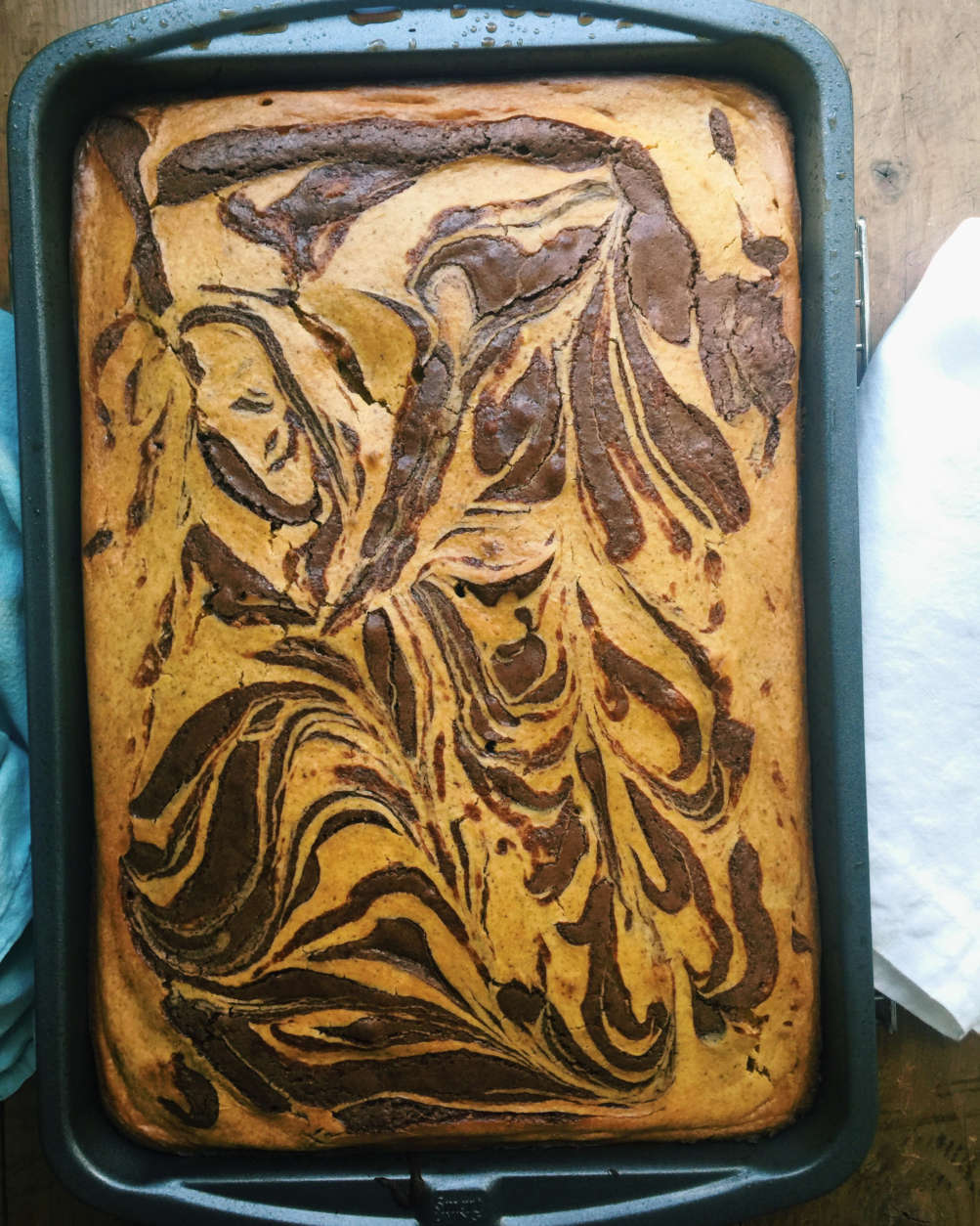 This September 2016 photo shows pumpkin cream cheese swirled chocolate brownies in New York. This dish is from a recipe by Katie Workman. (Katie Workman via AP)