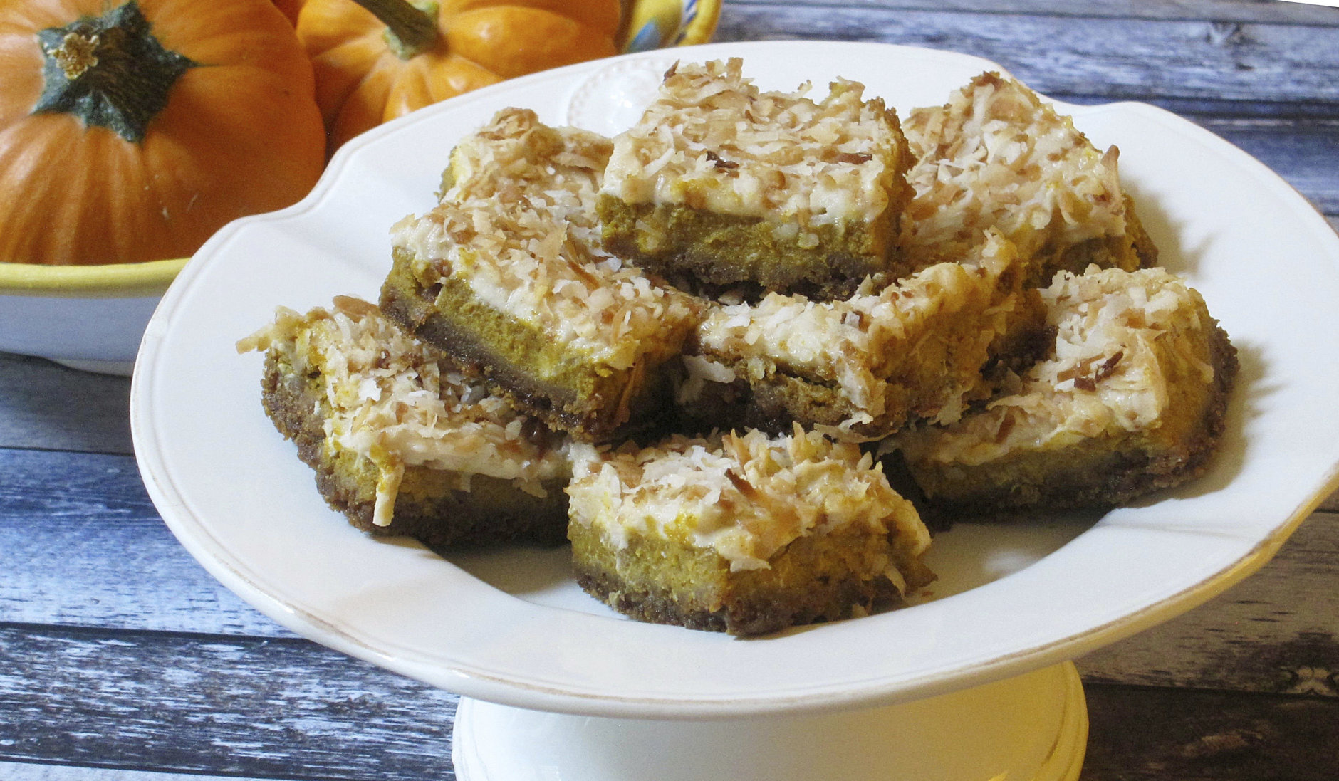 This Sept. 25, 2017 photo shows pumpkin coconut squares in New York. This dish is from a recipe by Sara Moulton. (Sara Moulton via AP)