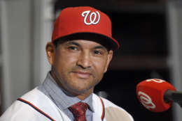 New Washington Nationals manager Dave Martinez listens during a baseball press conference, Thursday, Nov. 2, 2017, in Washington. (AP Photo/Nick Wass)