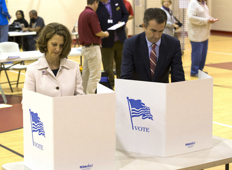 Democratic gubernatorial candidate Lt. Gov. Ralph Northam, and his wife, Pam, right, vote in Norfolk, Va., Tuesday, Nov. 7, 2017. Northam faces Republican Ed Gillespie in today's election. (AP Photo/Steve Helber)