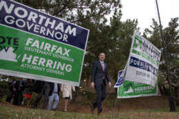 Democratic gubernatorial candidate Lt. Gov. Ralph Northam, walks past yard signs after voting in Norfolk, Va., Tuesday, Nov. 7, 2017. Northam faces Republican Ed Gillespie in today's election. (AP Photo/Steve Helber)