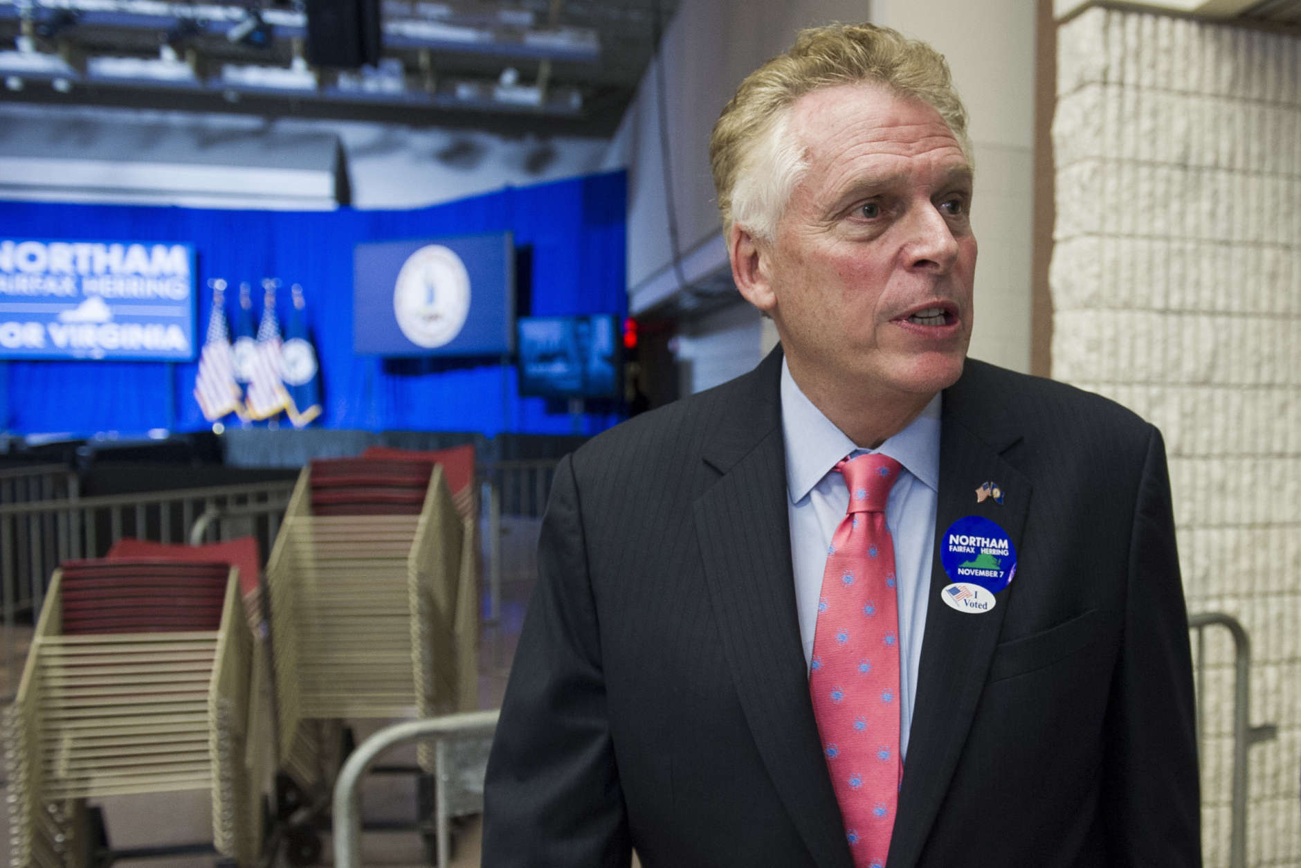 Virginia Gov. Terry McAuliffe waits to be interviewed by a reporter at the Northam For Governor election night party at George Mason University in Fairfax, Va., Tuesday, Nov. 7, 2017. (AP Photo/Cliff Owen)
