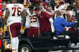 Washington Redskins running back Chris Thompson (25) is helped onto a cart after being injured in the second half of an NFL football game against the New Orleans Saints in New Orleans, Sunday, Nov. 19, 2017. (AP Photo/Butch Dill)