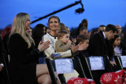 Ivanka Trump, holds her son Theodore Kushner as her husband Jared Kushner talks to daughter Arabella Kushner and their son Joseph Kushner, center, watches, along with Tiffany Trump, left, applaud during the National Christmas Tree lighting ceremony at the Ellipse near the White House in Washington, Thursday, Nov. 30, 2017. (AP Photo/Manuel Balce Ceneta)
