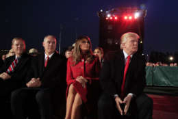 President Donald Trump and first lady Melania Trump, watch performances during the National Christmas Tree lighting ceremony at the Ellipse near the White House in Washington, Thursday, Nov. 30, 2017, with Interior Secretary Ryan Zinke, second from left. (AP Photo/Manuel Balce Ceneta)