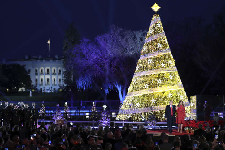 president donald trump and first lady melania trump stand after lighting the 2017 national christmas tree on the ellipse near the white house thursday