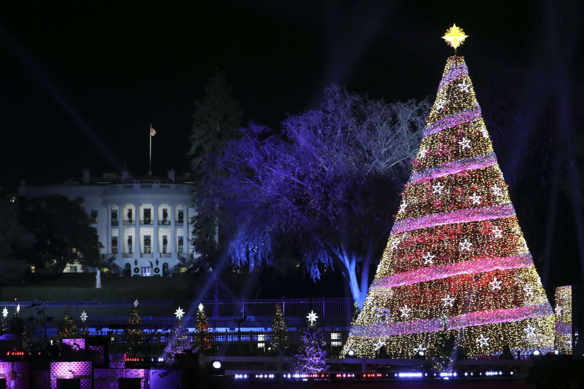 In this file photo, the 2017 National Christmas Tree is seen lit on the Ellipse with the White House in the background Thursday, Nov. 30, 2017, in Washington. (AP Photo/Andrew Harnik)
