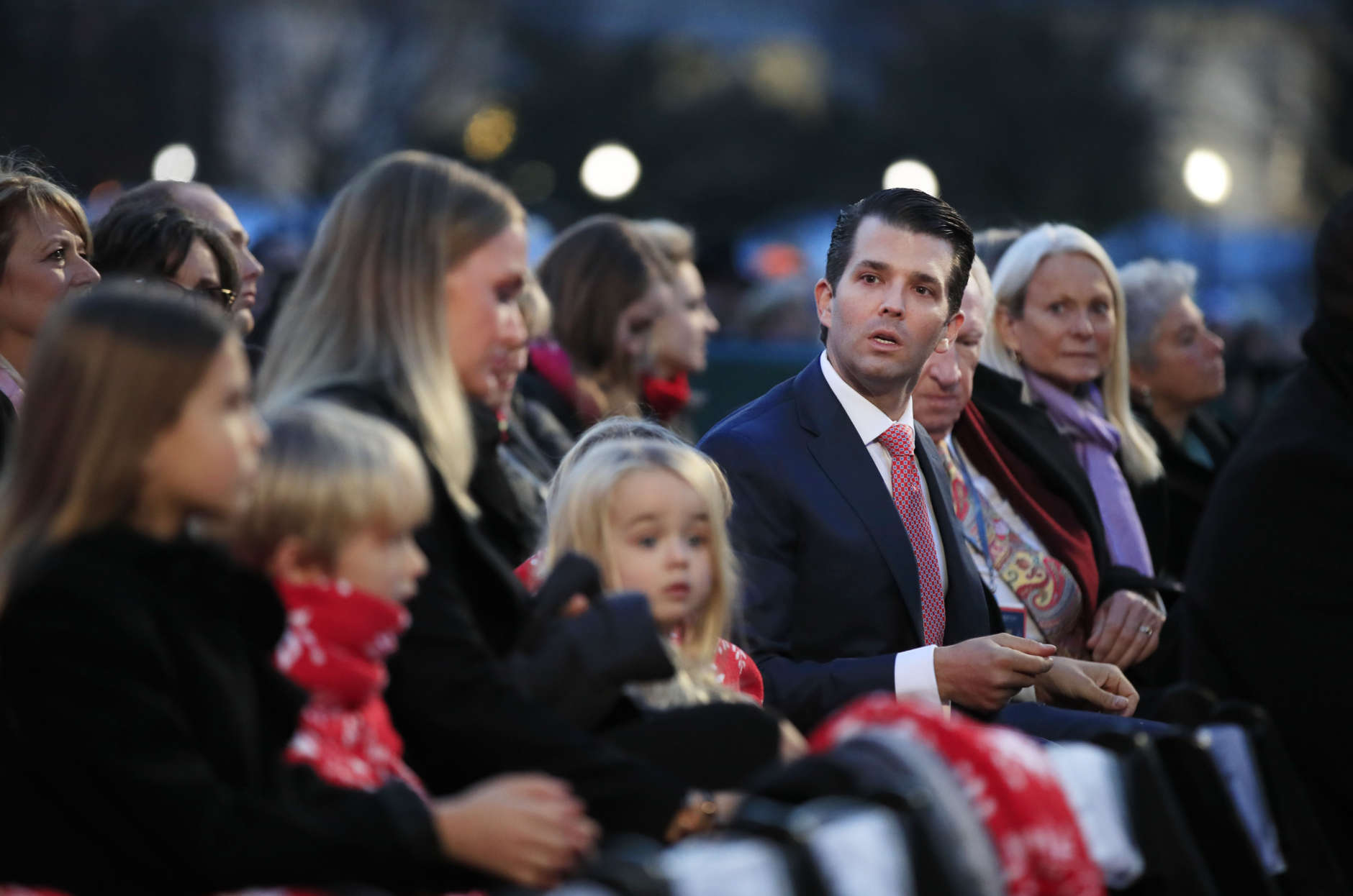 Donald Trump Jr., his wife Vanessa Trump, and their family watch performances during the National Christmas Tree lighting ceremony at the Ellipse near the White House in Washington, Thursday, Nov. 30, 2017. (AP Photo/Manuel Balce Ceneta)