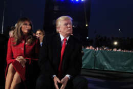 President Donald Trump and first lady Melania Trump watch performances during the National Christmas Tree lighting ceremony at the Ellipse near the White House in Washington, Thursday, Nov. 30, 2017. (AP Photo/Manuel Balce Ceneta)