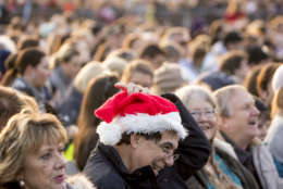 A member of the audience wear Christmas hats at the lighting ceremony for the 2017 National Christmas Tree on the Ellipse near the White House, Thursday, Nov. 30, 2017, in Washington. (AP Photo/Andrew Harnik)