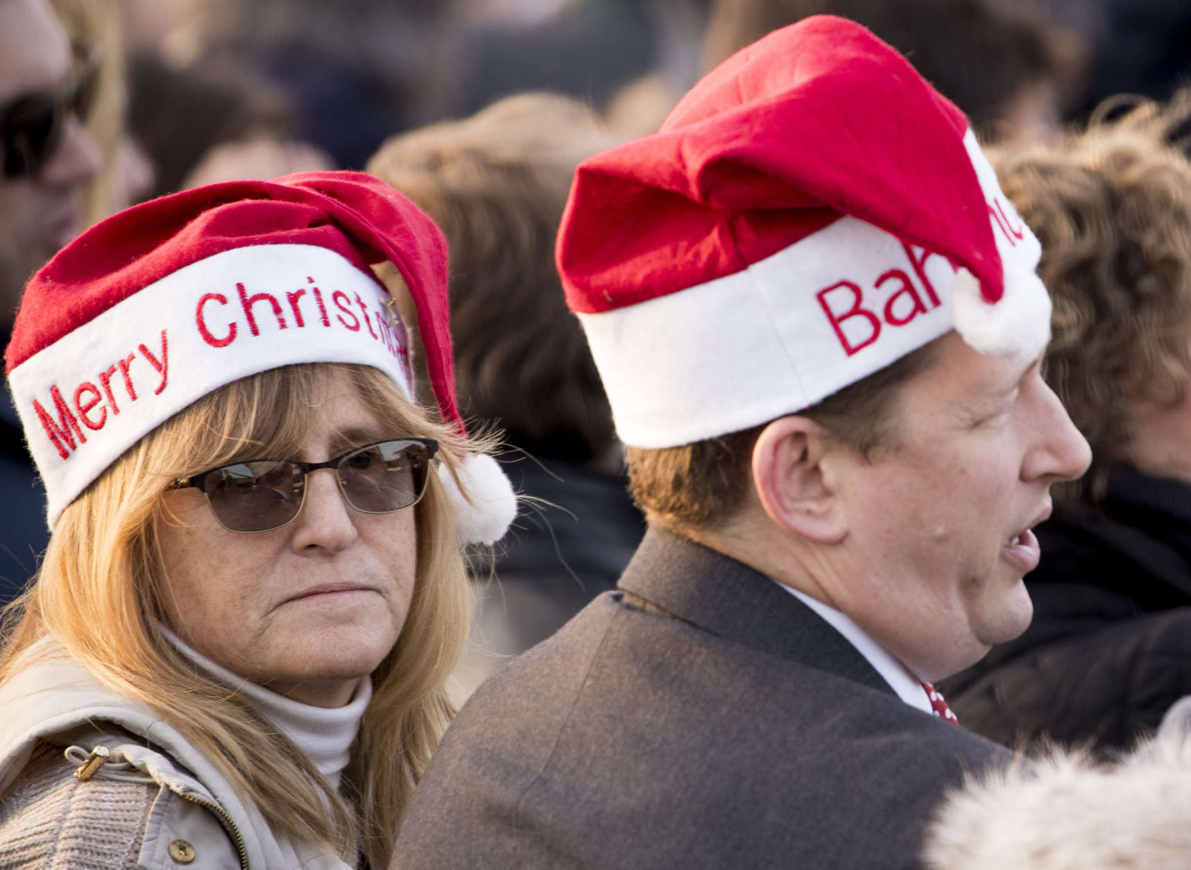 Members of the audience wear Christmas hats at the lighting ceremony for the 2017 National Christmas Tree on the Ellipse near the White House, Thursday, Nov. 30, 2017, in Washington. (AP Photo/Andrew Harnik)