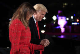 President Donald Trump holds first lady Melania Trump's hand as they walk back to the stage during the lighting ceremony for the 2017 National Christmas Tree on the Ellipse near the White House in Washington, Thursday, Nov. 30, 2017. (AP Photo/Manuel Balce Ceneta)