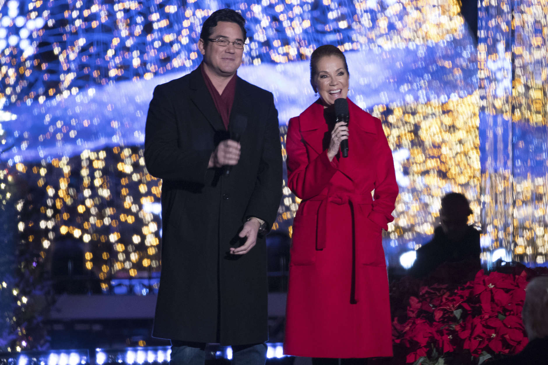 Hosts Kathie Lee Gifford and actor Dean Cain speak during the lighting ceremony for the 2017 National Christmas Tree on the Ellipse near the White House, Thursday, Nov. 30, 2017, in Washington. (AP Photo/Andrew Harnik)