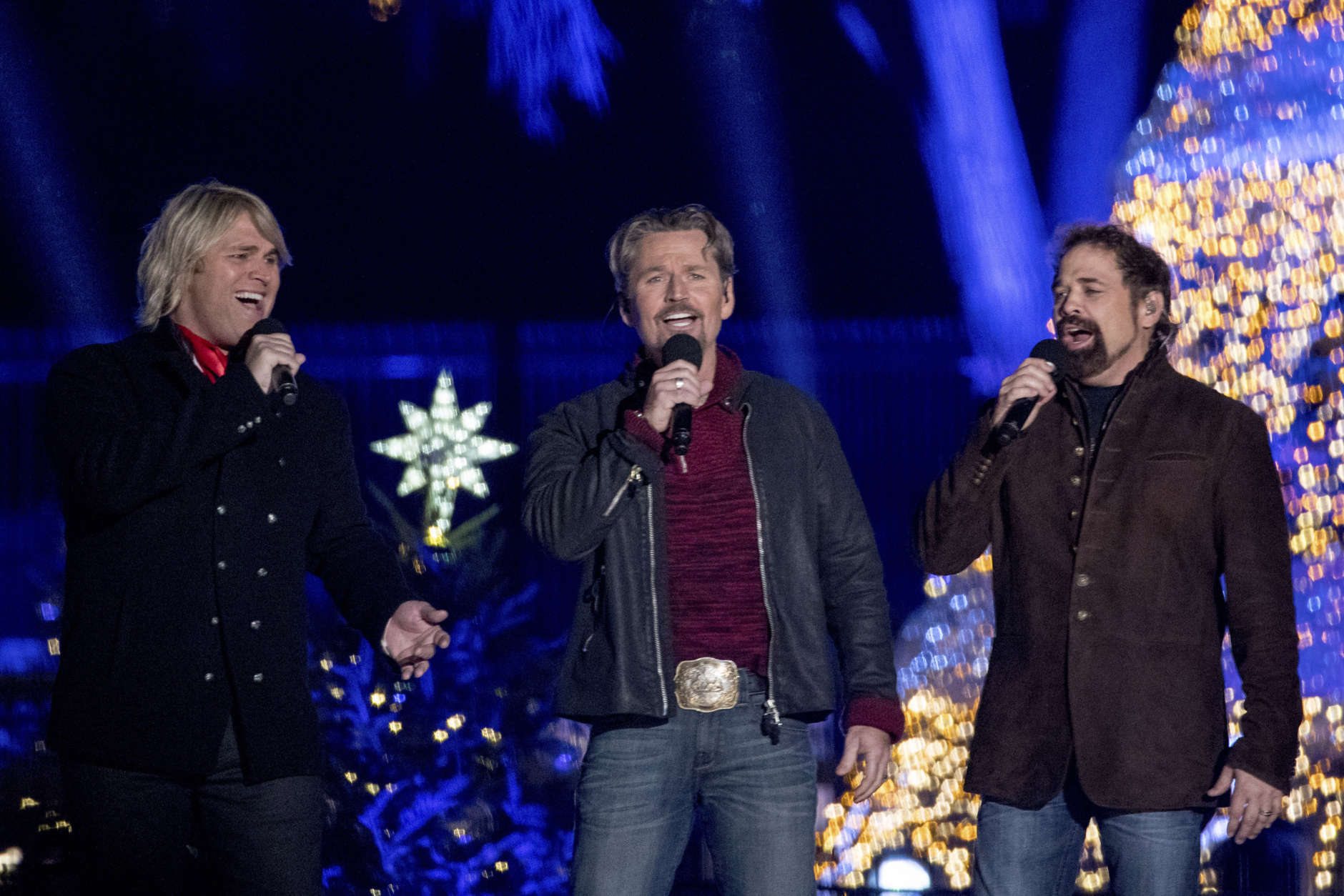 The Texas Tenors perform during the lighting ceremony for the 2017 National Christmas Tree on the Ellipse near the White House, Thursday, Nov. 30, 2017, in Washington. (AP Photo/Andrew Harnik)