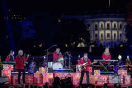 Chip Davis and the Mannheim Steamroller perform during the lighting ceremony for the 2017 National Christmas Tree on the Ellipse near the White House, Thursday, Nov. 30, 2017, in Washington. (AP Photo/Andrew Harnik)