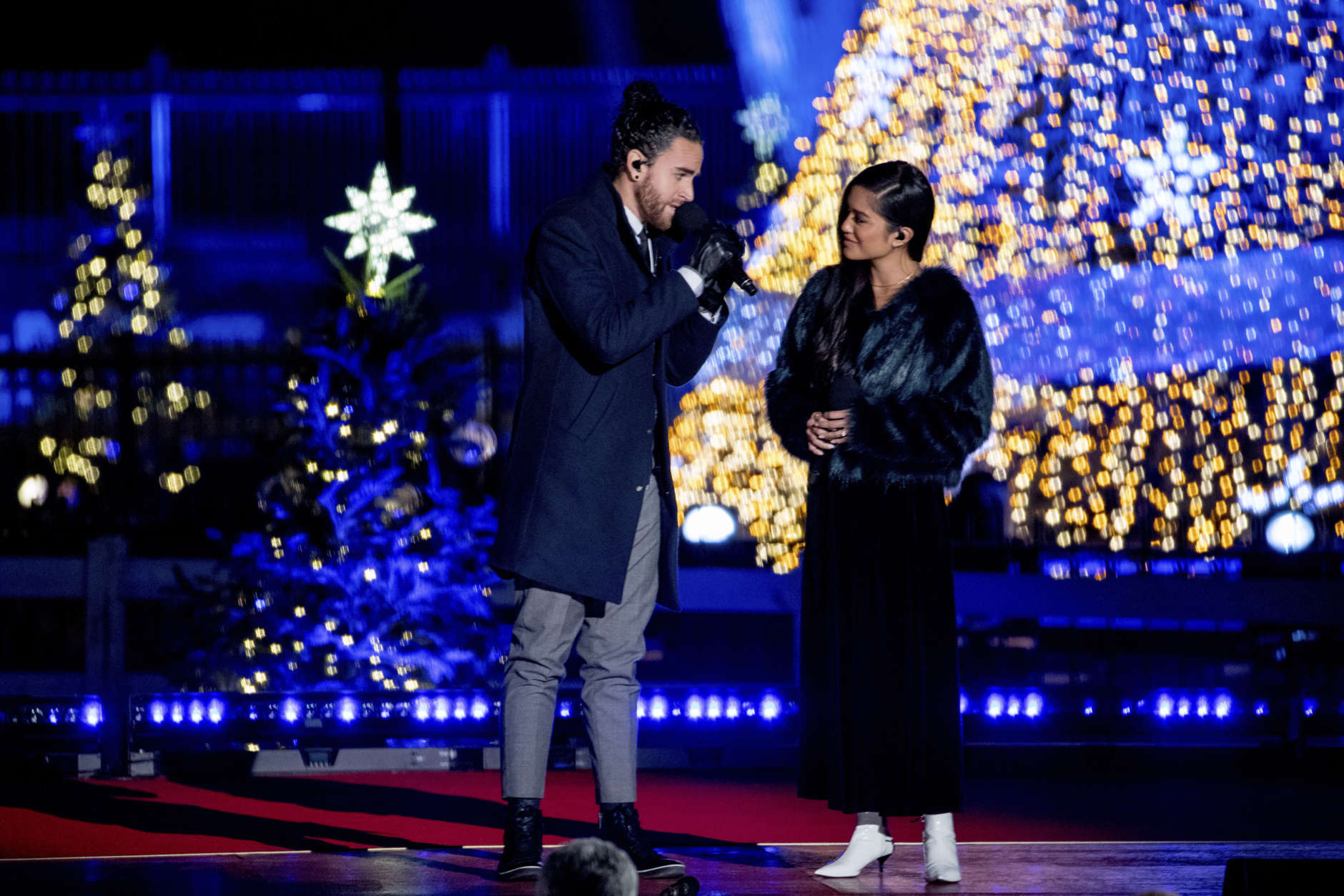 Us The Duo featuring Michael and Carissa Alvarado perform during the lighting ceremony for the 2017 National Christmas Tree on the Ellipse near the White House, Thursday, Nov. 30, 2017, in Washington. (AP Photo/Andrew Harnik)