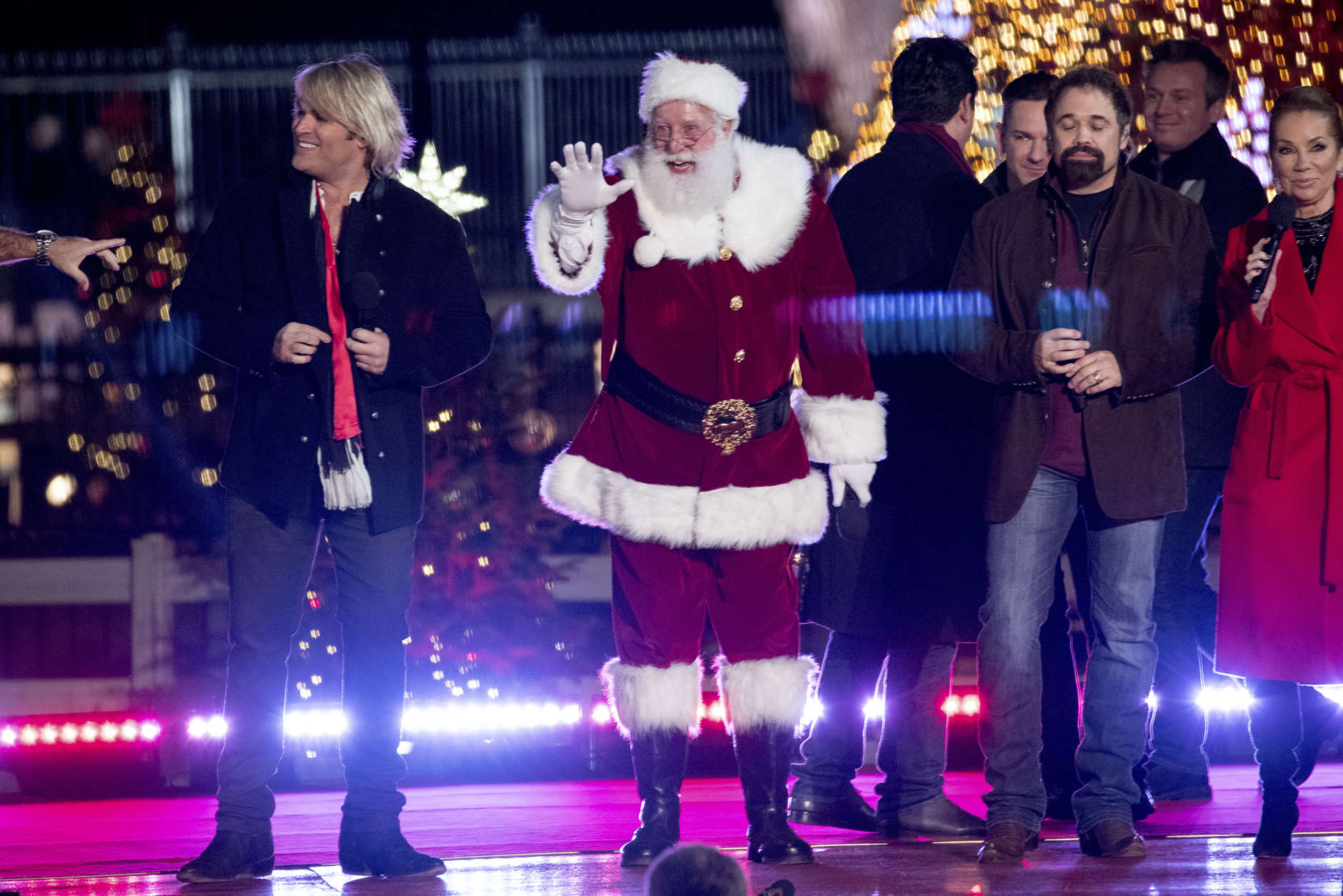Santa Claus appears onstage along with performers at the end of the lighting ceremony for the 2017 National Christmas Tree on the Ellipse near the White House, Thursday, Nov. 30, 2017, in Washington. (AP Photo/Andrew Harnik)