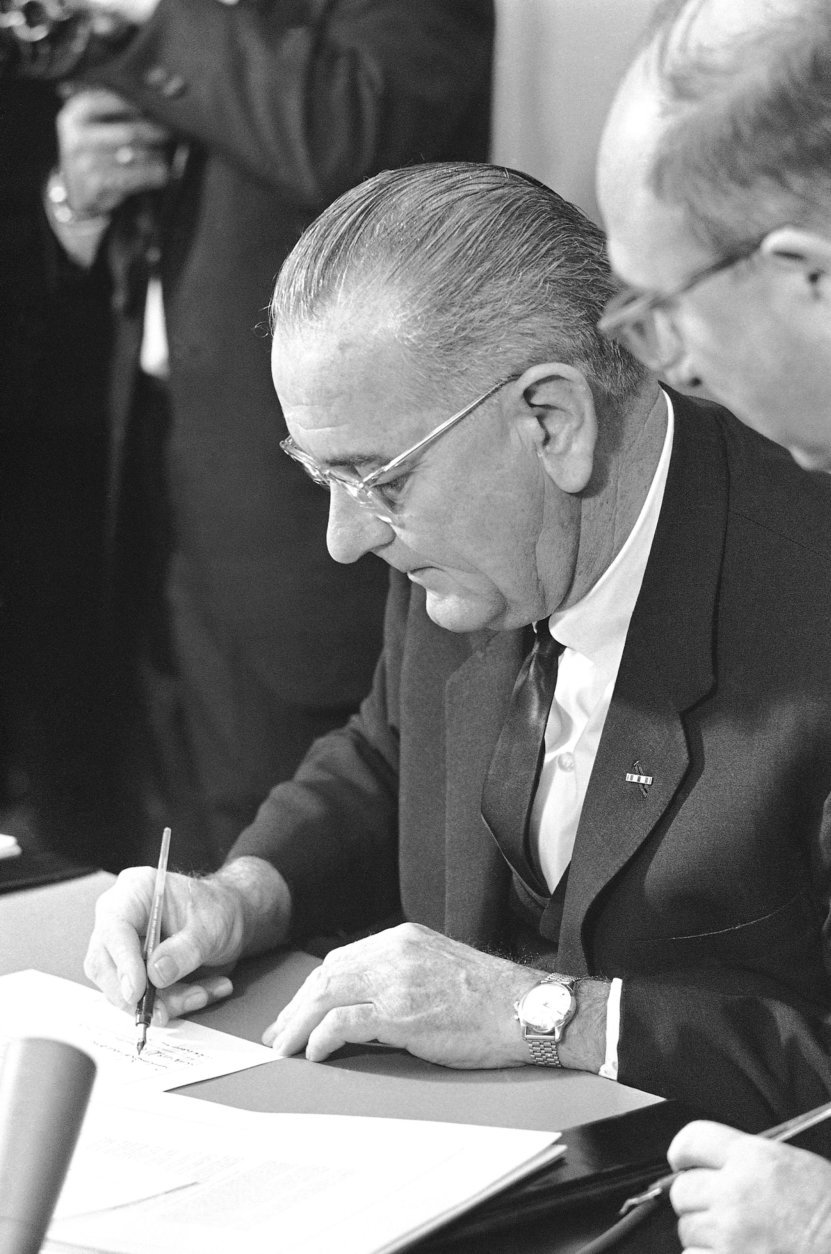 President Lyndon Johnson signing Clean Air Act in Washington on December 17, 1963 . (AP Photo/Henry Burroughs)