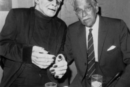 Actor Boris Karloff, right, gets a look at what he looked like in movies not too many years ago, at a party in Karloff's honor at the Magic Castle in Hollywood, an old mansion where magicians meet, April 18, 1967.  Manuel Welton is inside the Frankenstein costume.  (AP Photo/Harold P. Matosian)