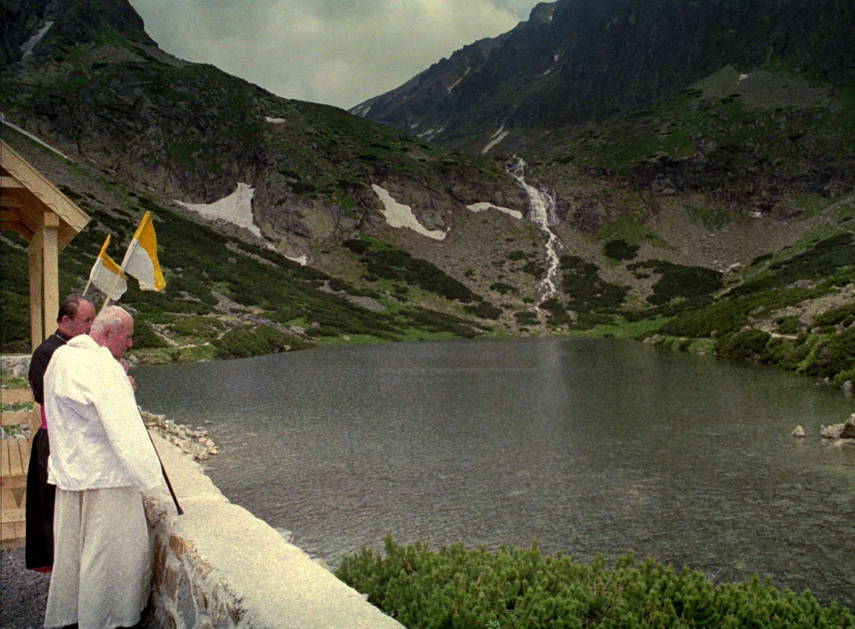 Pope John Paul II stands at the Velicke pleso lake in the Tatra mountains near Stary Smokovec, Monday, July 3, 1995. Monday is the last day of a four-day-trip of the Pope to Slovakia. (AP Photo/ Vatican Pool / Arturo Mari)