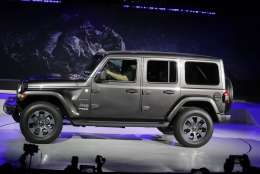 The 2019 Jeep Wrangler is introduced during the Los Angeles Auto Show, Wednesday, Nov. 29, 2017, in Los Angeles. (AP Photo/Chris Carlson)