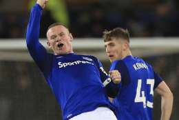 Everton's Wayne Rooney, left. celebrates scoring his side's third goal of the game during the English Premier League soccer match at Goodison Park in Liverpool, England, Wednesday Nov. 29, 2017. ( Byrne/PA via AP)