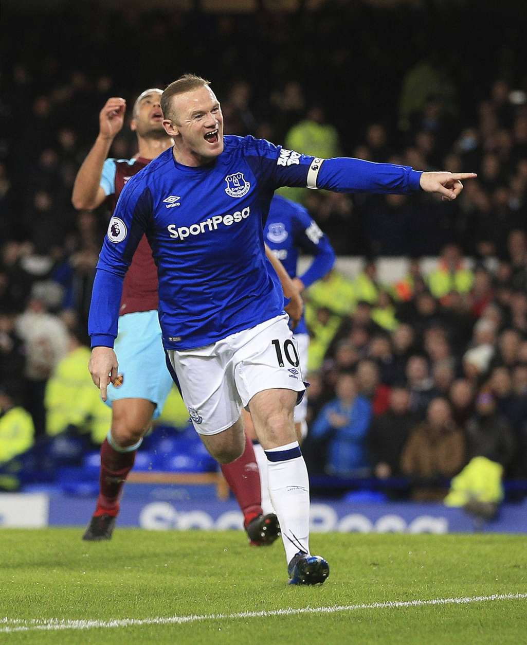Everton's Wayne Rooney celebrates scoring his side's first goal against West Ham United during the English Premier League soccer match at Goodison Park, Liverpool, England, Wednesday Nov. 29, 2017. (Peter Byrne/PA via AP)