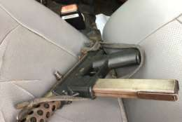 A photo of a firearm recovered from driver's seat of the suspects' vehicle. Four suspects are in custody, police said. (Courtesy Montgomery County police)
