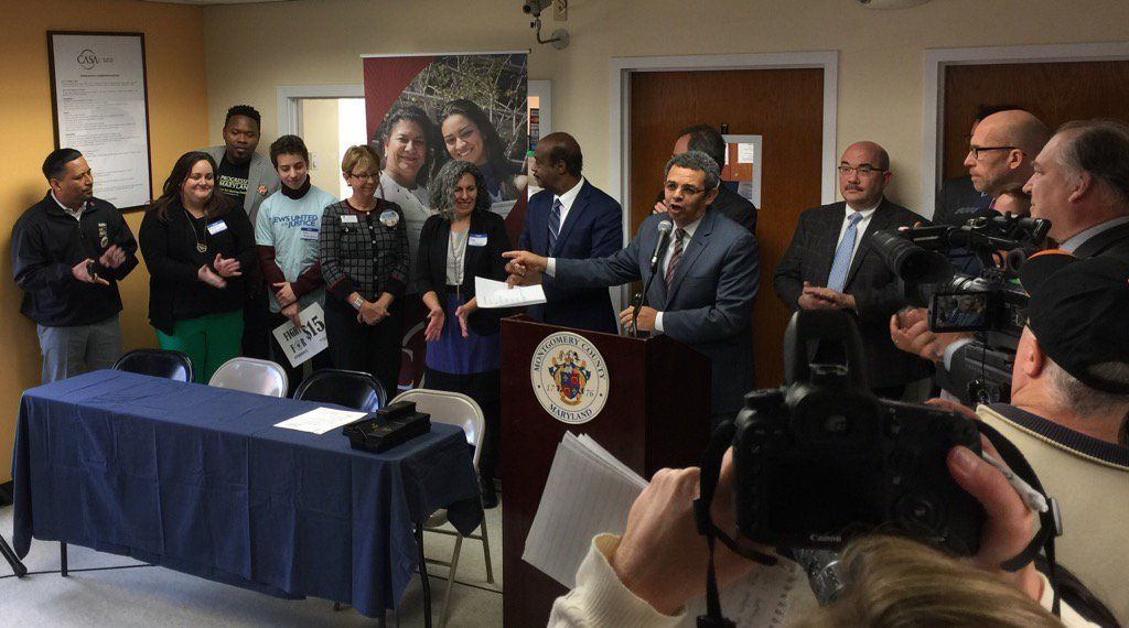 Gustavo Torres of Casa de Maryland speaks at the signing of the bill for the $15 minimum wage in Montgomery County. (WTOP/Kristi King)