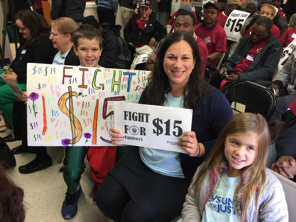 Avi, Laura and Naomi Wallace at the $15 minimum wage bill signing in Montgomery County. (WTOP/Kristi King)