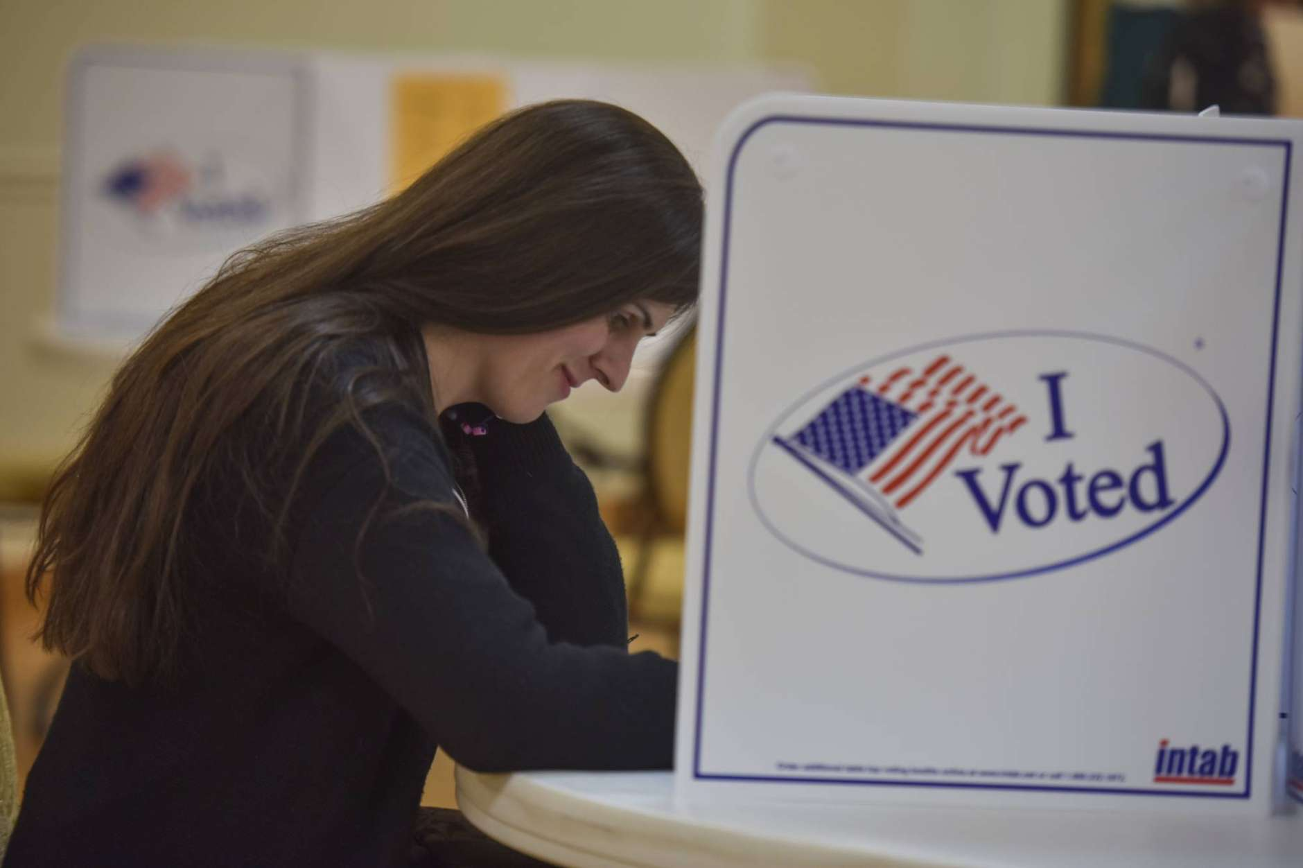 Danica Roem, who is running for house of delegates against GOP incumbent Robert Marshall, casts her vote at Buckhall Volunteer Fire Department on Tuesday, Nov. 7, 2017, in Manassas, Va. If Roem wins, she would be the first transgender legislator elected in the USA. (Jahi Chikwendiu/The Washington Post via AP)