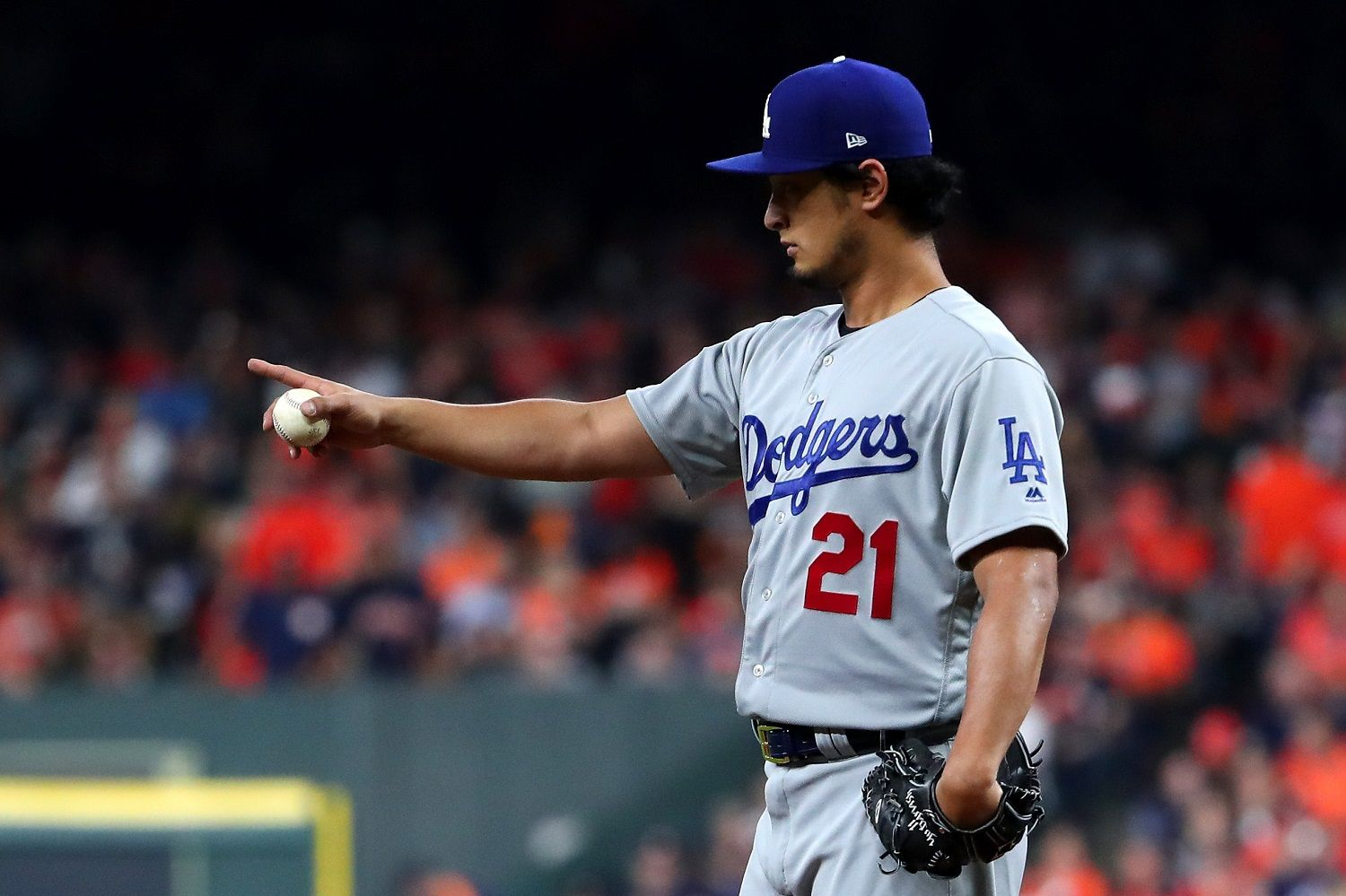 HOUSTON, TX - OCTOBER 27:  Yu Darvish #21 of the Los Angeles Dodgers reacts during the second inning against the Los Angeles Dodgers in game three of the 2017 World Series at Minute Maid Park on October 27, 2017 in Houston, Texas.  (Photo by Tom Pennington/Getty Images)