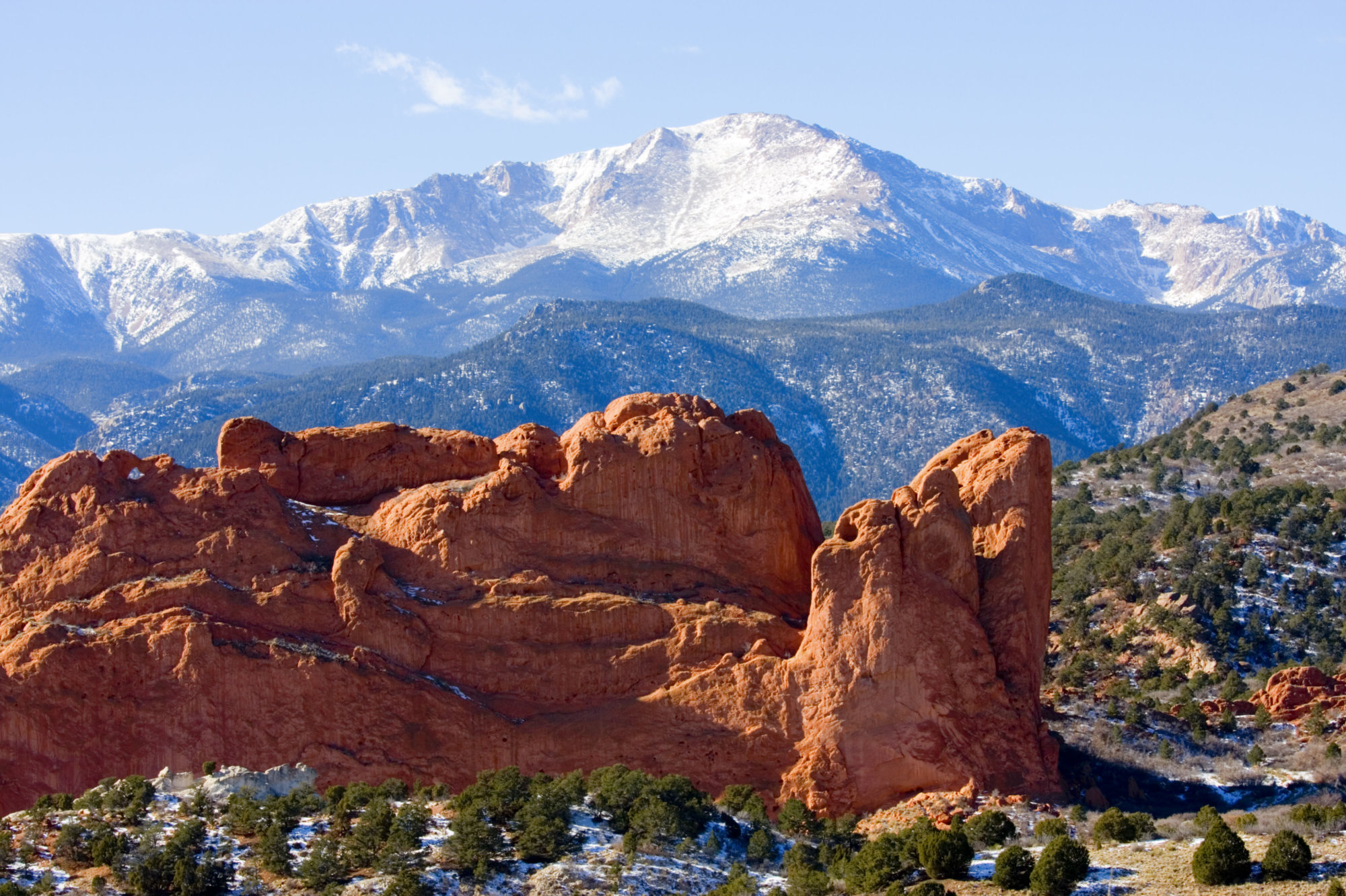 Snow covered Garden of the Gods Park in Colorado Springs at the base of 14000 foot Pikes Peak in the wintertime.
